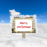 Snow field and blue sky with wooden sign board Royalty Free Stock Photo