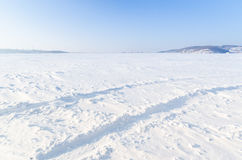 Snow field with car wheels trails. Field with trails of wheels covered with snow    in Harbin, China Royalty Free Stock Images