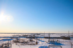 Snow field with gas pipes Royalty Free Stock Images