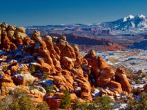 Snow on the Fiery Furnace of Arches. Arches National Park in Utah offers spectacular views of mountains and rock formations.  Beautiful in Winter.  Near Moab Royalty Free Stock Image