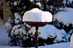 Snow Filled Bird Bath Royalty Free Stock Image