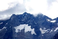 Snow filled mountains with clouds Royalty Free Stock Photos