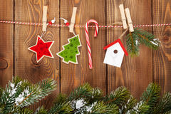 Snow fir tree and christmas decor on rope Stock Images