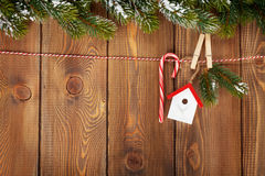 Snow fir tree and christmas decor on rope Royalty Free Stock Photos