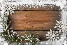 Snow fir tree with cones over wooden background, copy space Stock Image