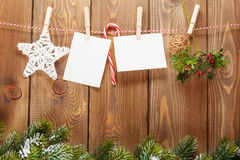 Snow fir tree, photo frame and christmas decor on rope Royalty Free Stock Photo