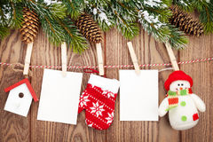 Snow fir tree, photo frames and christmas decor on rope over rus Royalty Free Stock Image