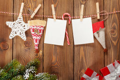 Snow fir tree, photo frames and christmas decor on rope Royalty Free Stock Photo
