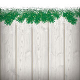 Snow Fir Twigs Bokeh Wood Laths. Fir twigs with snow on the wooden background Stock Photography