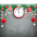 Snow Fir Twigs Concrete Red Stars Baubles Clock 2017. Fir twigs with snow, clock and red baubles on the concrete Royalty Free Stock Image