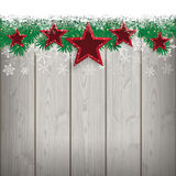 Snow Fir Twigs Wood Laths 5 Red Stars. Fir twigs with snow and red stars on the wooden background Royalty Free Stock Images