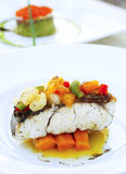 Snow fish with carrot Royalty Free Stock Image