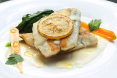 Snow fish grilled white sauce Royalty Free Stock Image
