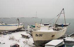 Snow on the fishing boats in Pomorie, Bulgaria stock image