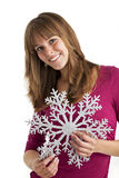 Snow flake. Young woman holding a decorative snow flake Stock Image