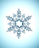 Snow flake. Single geometrical snow flake blue background Stock Images