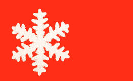 Snow flake. On a red background Royalty Free Stock Image