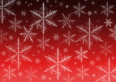 Snow Flake Christmas. Multiple snow flakes falling to ground against a dark/red background Royalty Free Stock Photography