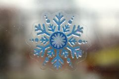 Snow-flake on the glass of window Royalty Free Stock Photos