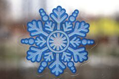 Snow-flake on the glass of window Royalty Free Stock Photo