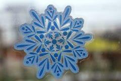 Snow-flake on the glass of window Stock Photos