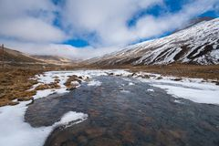 Snow flake beside River from snow ice melt on mountain Landscape Stock Image