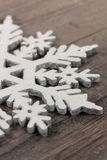Snow flake. Shape on wooden table Stock Images