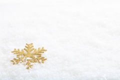 Snow flake on snow background Royalty Free Stock Photos