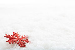 Snow flake on snow background. Red snow flake on snow background Royalty Free Stock Photos