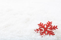 Snow flake on snow background. Red snow flake on snow background Stock Images