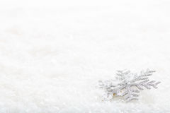 Snow flake on snow background. Silver snow flake on snow background Stock Photo
