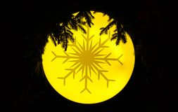 Snow flake. A snow flake design on an yellow christmas tree ornament Stock Image