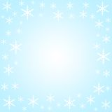 Snow flakes border. On light blue Stock Images