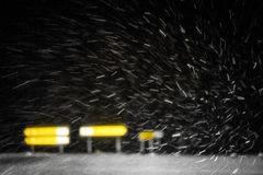 Snow flakes flying in front of the car Royalty Free Stock Image