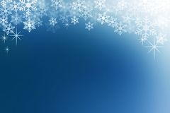 Snow flakes on midnight blue abstract winter background. Stock Photography