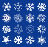 Snow flakes. Set of original stylized snow flakes on the dark blue background. Vector available royalty free illustration