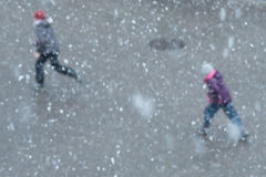 Snow flakes and unsharp children Stock Images