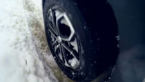 Snow flies into camera. Tire slipping and sliding on snow. On board camera. Close up. stock video