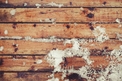 Snow on floorboard during winter. Top view, vintage toned image, copy space Stock Image