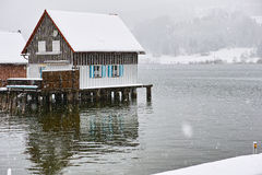 Stilt house at lake by snow flurry Royalty Free Stock Image