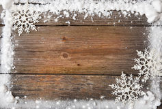 Snow frame with snowflakes over wooden background, copy space Stock Images