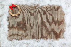 Snow frame and straw wreath with a bow. Stock Photo