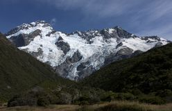 Snow and frozen ice on a rock near Mount Cook in the Aoraki National Park in the South Island in New Zealand stock image