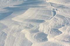 Snow on the frozen surface of the river, a natural background, Ob reservoir, Siberia. Snow on the frozen surface of the river, natural background, Ob reservoir stock photo