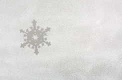 Snow on the frozen window with snowflakes Stock Image