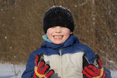Snow fun. Young boy 6 years old playing with snow Royalty Free Stock Photos