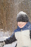 Snow fun. Young boy 6 years old playing with snow Royalty Free Stock Image