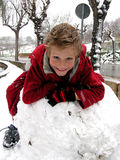 Snow fun. Happy child playing in snow Royalty Free Stock Image