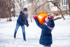 Snow fun father with daugther, winter activity stock images