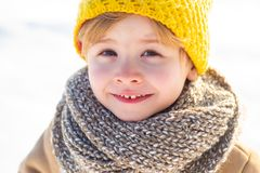 Snow games. Winter holidays concept. Have wonderful holiday. Happy new year and merry christmas. Happy winter child snow. Background. Cute boy in winter clothes royalty free stock photo